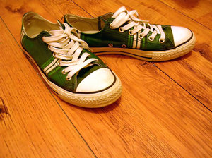 green converse on wooden floor