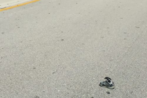 Toddler shoe in road